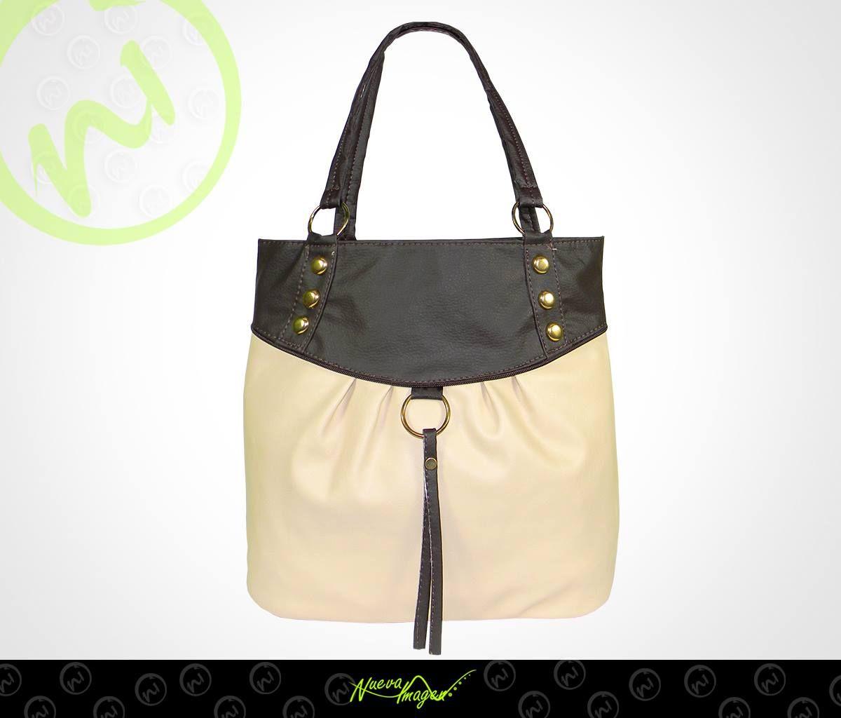 ¿En qué ocasión usarías esta bolsa con aplicaciones metálicas? Visita nuestra tienda en línea: http://www.distribuidoranuevaimagen.com/ :)