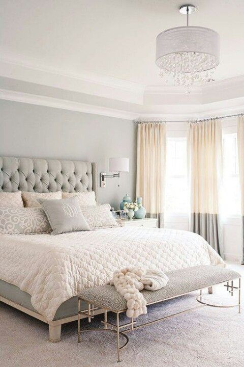 Love the headboard with diamond tufting and the modern bench.