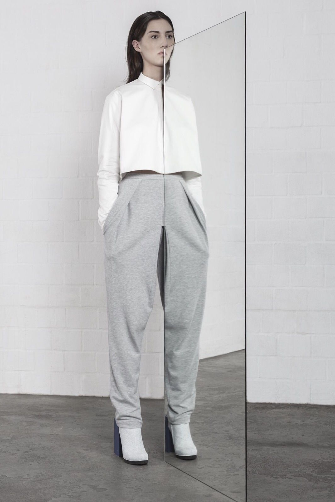 A mirror-inspired collection by Leonie Barth titled I is Another — no-nonsense avant-garde fashion.  Full article & more images on Minimalissimo.  #minimalism #fashion #design #mirror