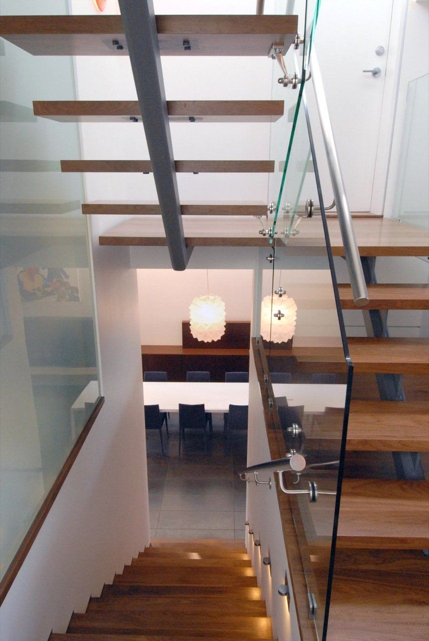 I'm a sucker for glass, wood and open space. Simply beautiful stairs