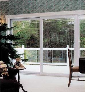 The Park Avenue® Sliding Patio Door with triple pane glass opens ...