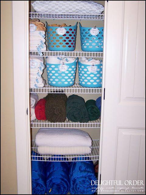 Dollar Tree baskets for linen closet organization.