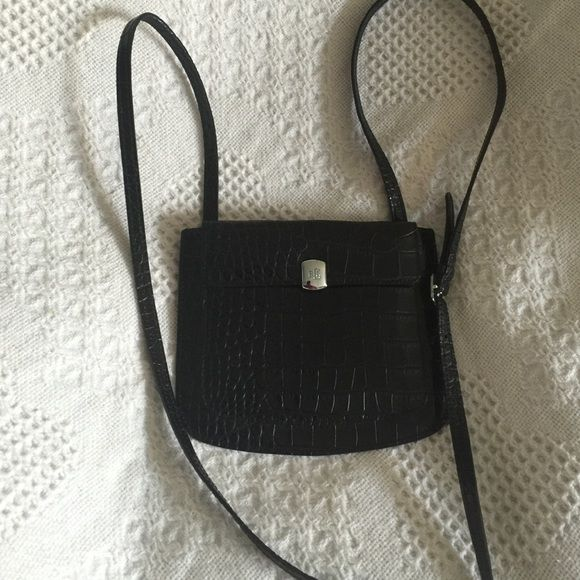 Ralph Lauren cross body pouch! Small black leather pouch with silver hardware. Perfect for a night out, somewhere to put your ID and currency! Ralph Lauren Bags Crossbody Bags
