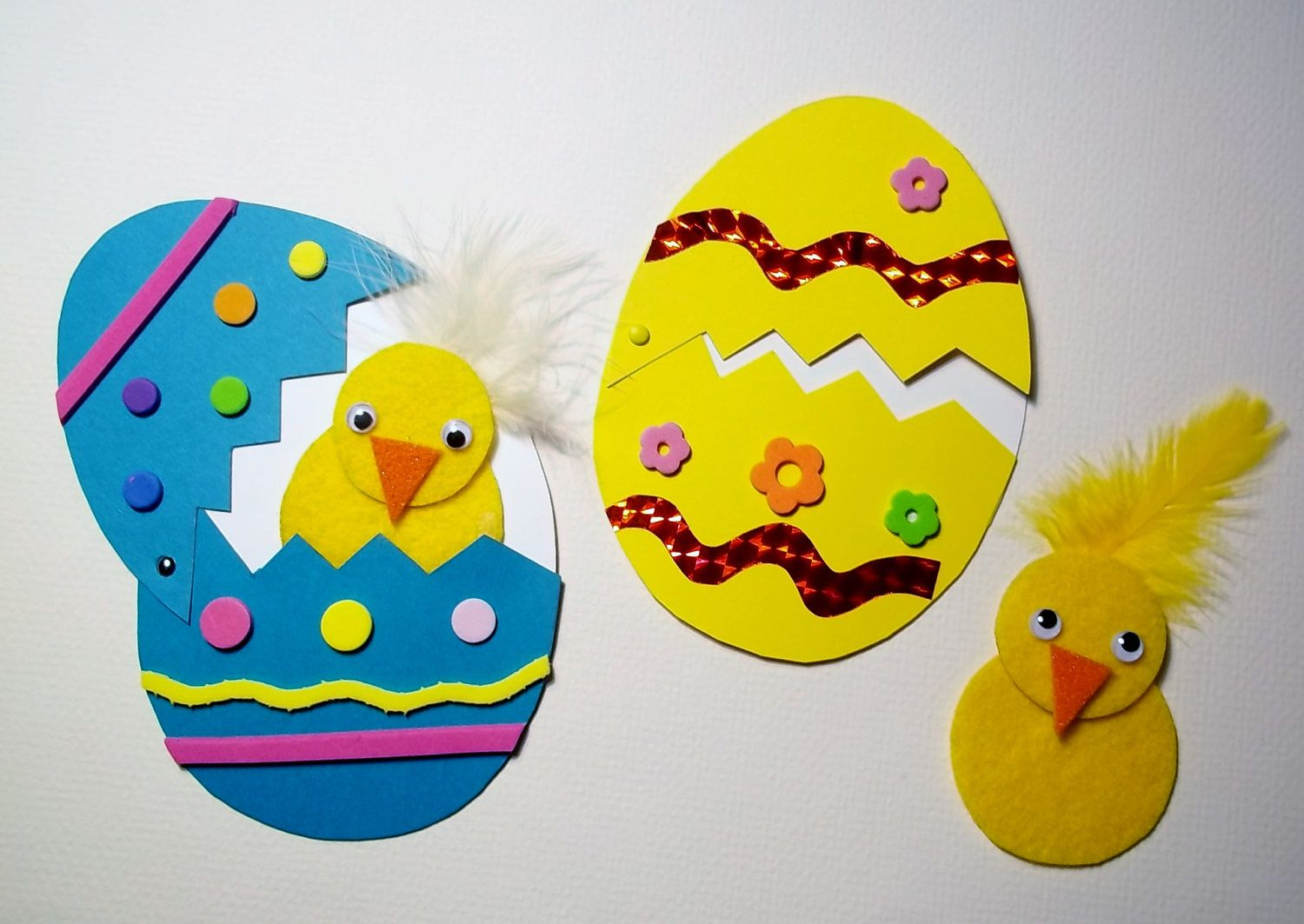 Creative Easter Newborn Chicks Craft With Yellow And White Furs Also Patterned Blue Eggs