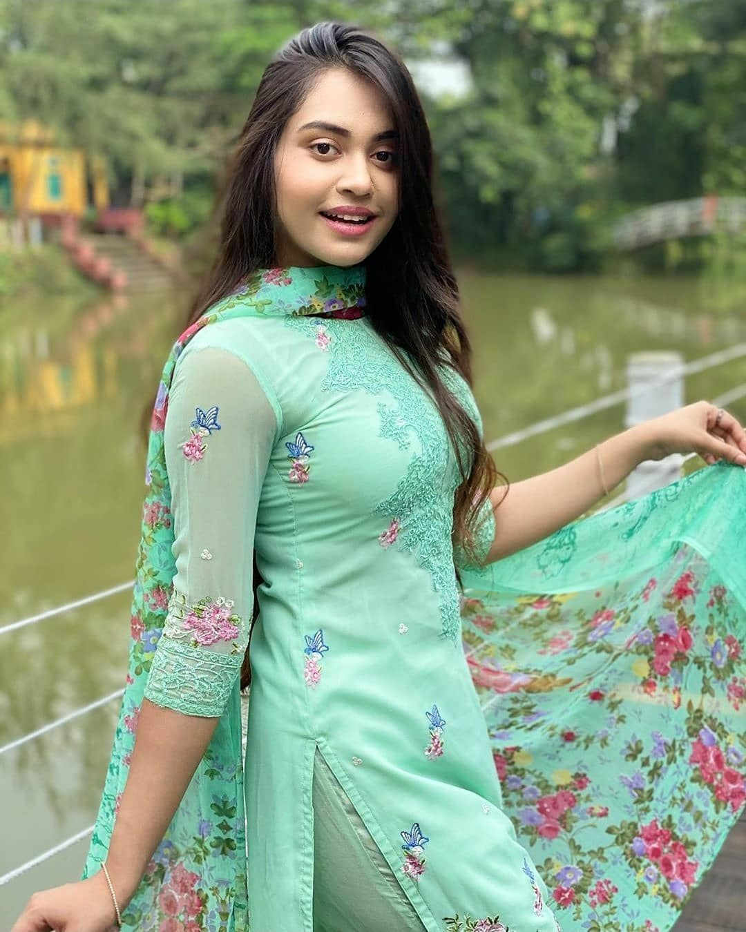 Indian desi college girl in red tight salwar kameez dress