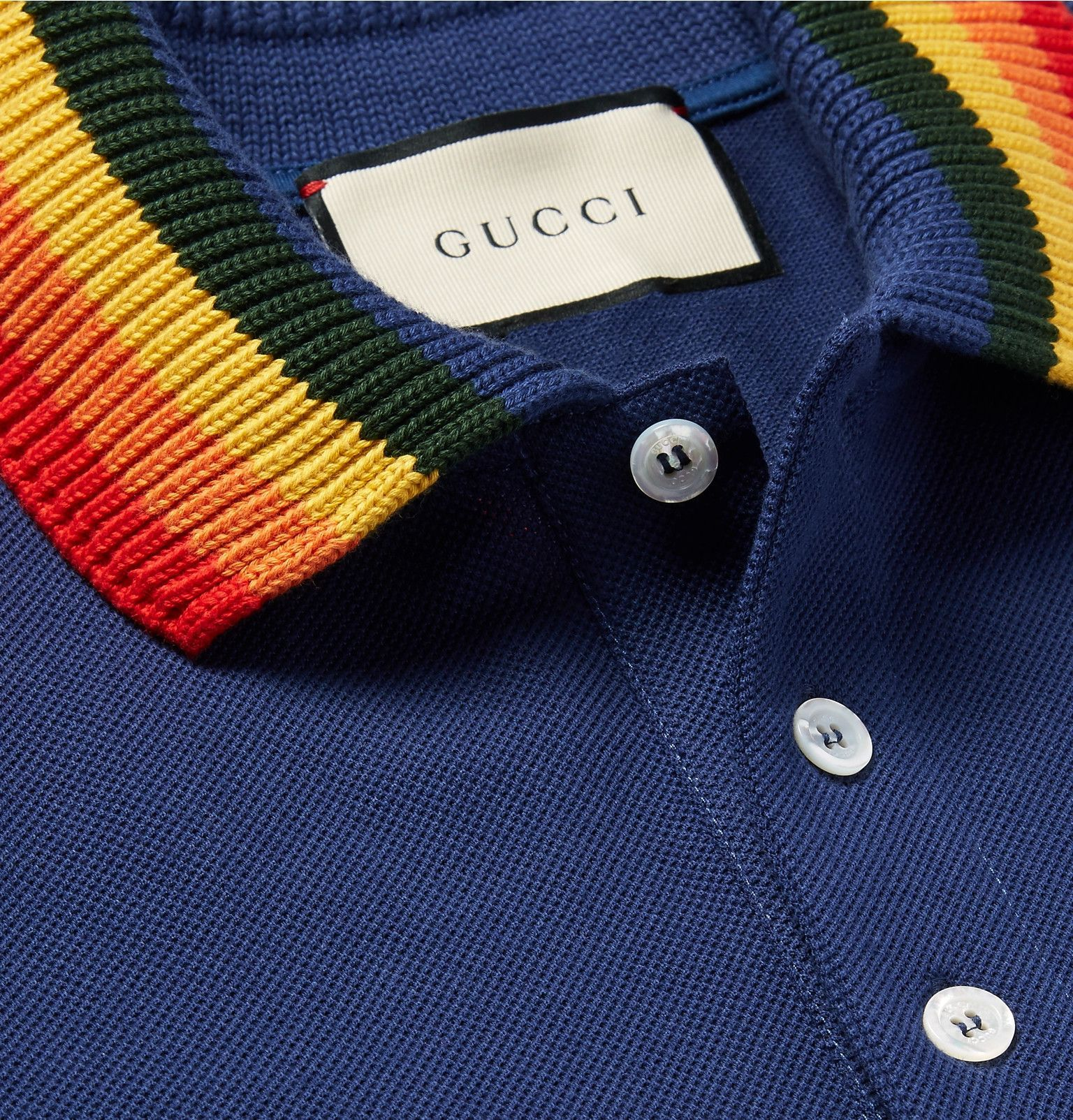 5f0d1bc13ee6 This Gucci polo shirt has a contrasting knitted collar in bold rainbow  stripes. It's been