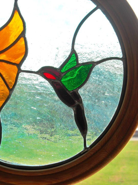 windowcandy/close up of hummingbird panel