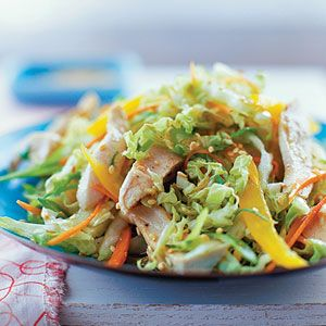Poaching results in tender, juicy chicken with no added fat for this colorful, Asian-inspired salad.