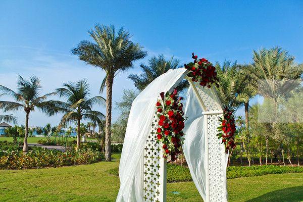 red wedding theme. aghareed weddings. wedding planner. set up. ceremony. reception. wedding designer. dubai