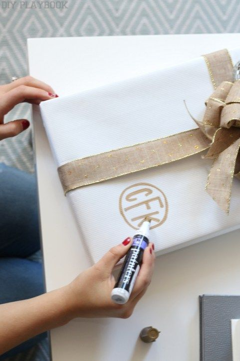f412d92a34cc How to make monogrammed gift wrap for Christmas. Add a personal touch to  your gifts with a paint marker