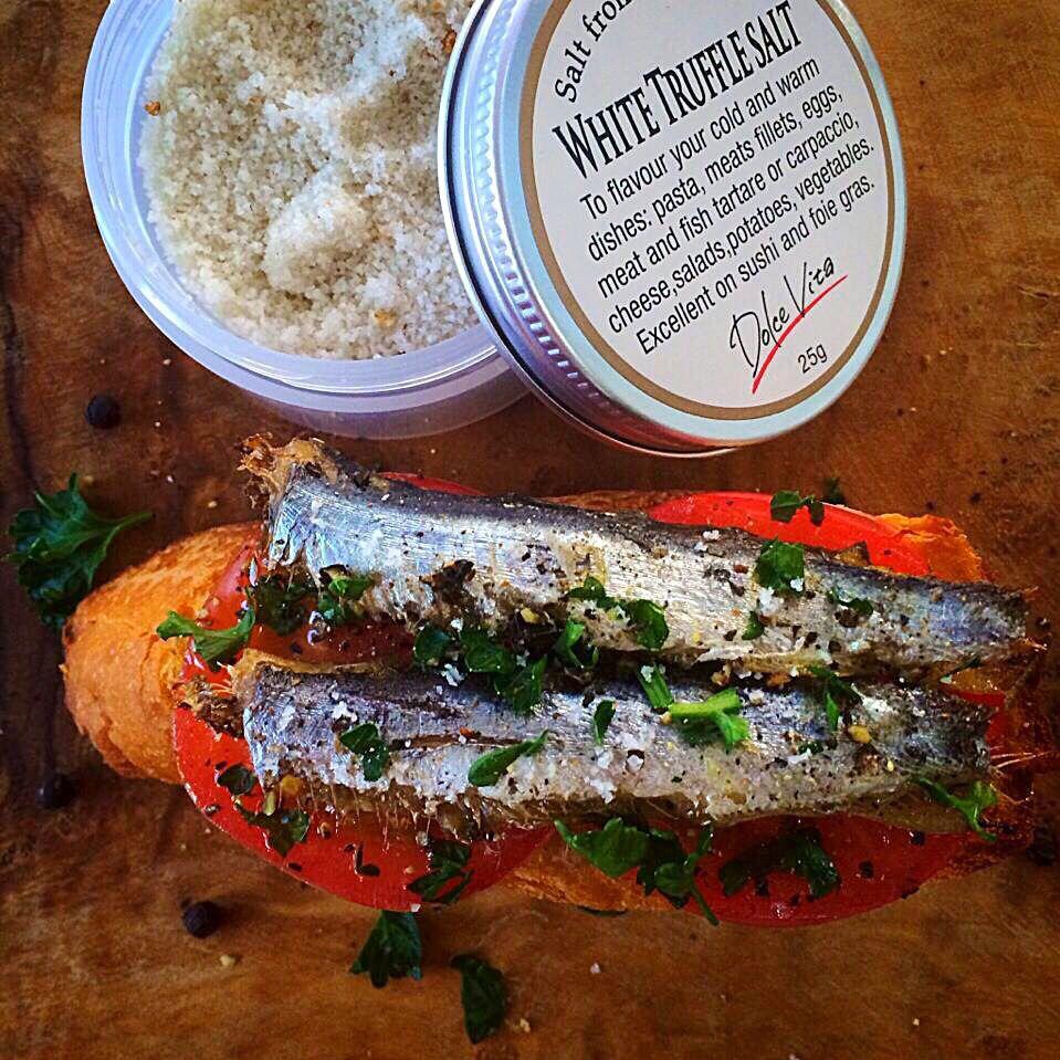 Homemade oiled sardines on baguette with white truffle salt