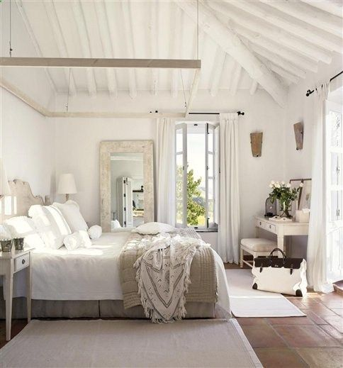perfect beach house guest bedroom - love the big mirror with the