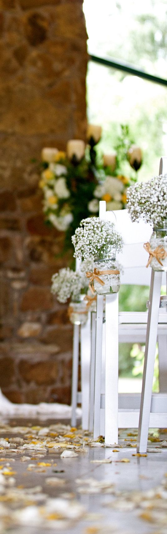 Set of vintage inspired mason jar vases for wedding ceremony