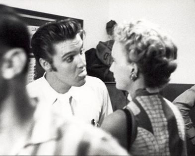 Elvis with Anne Rowe, a reporter for the St. Petersburg Times, in Tampa, Florida on August 5, 1956.