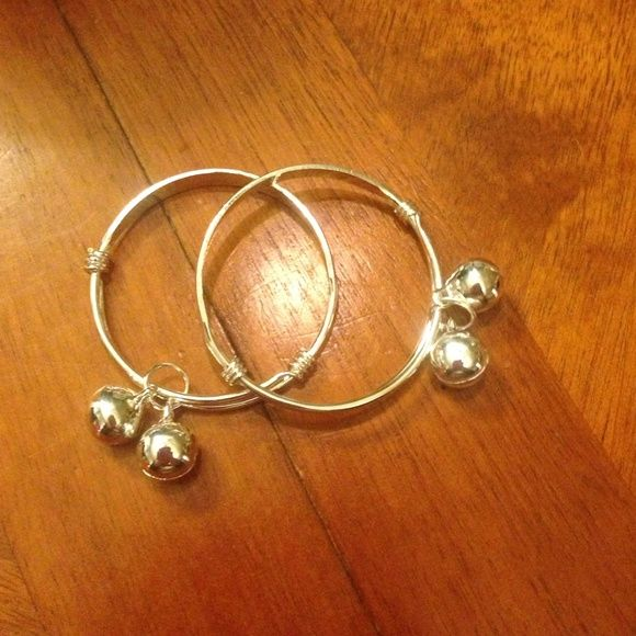 "Sterling silver BABY bangle bracelets Sterling silver BABY bangle bracelets. They say ""Somebody Loves Me""   ALL JEWELRY BUY TWO GET ONE FREE  Let me know which items you'd like and I'll create a separate listing for you! Jewelry Bracelets"