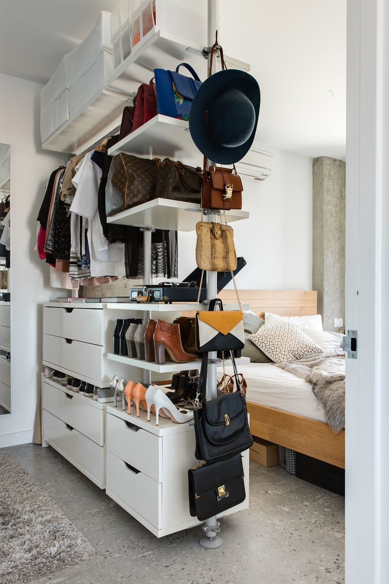 Bedroom with open wardrobe room divider compact living