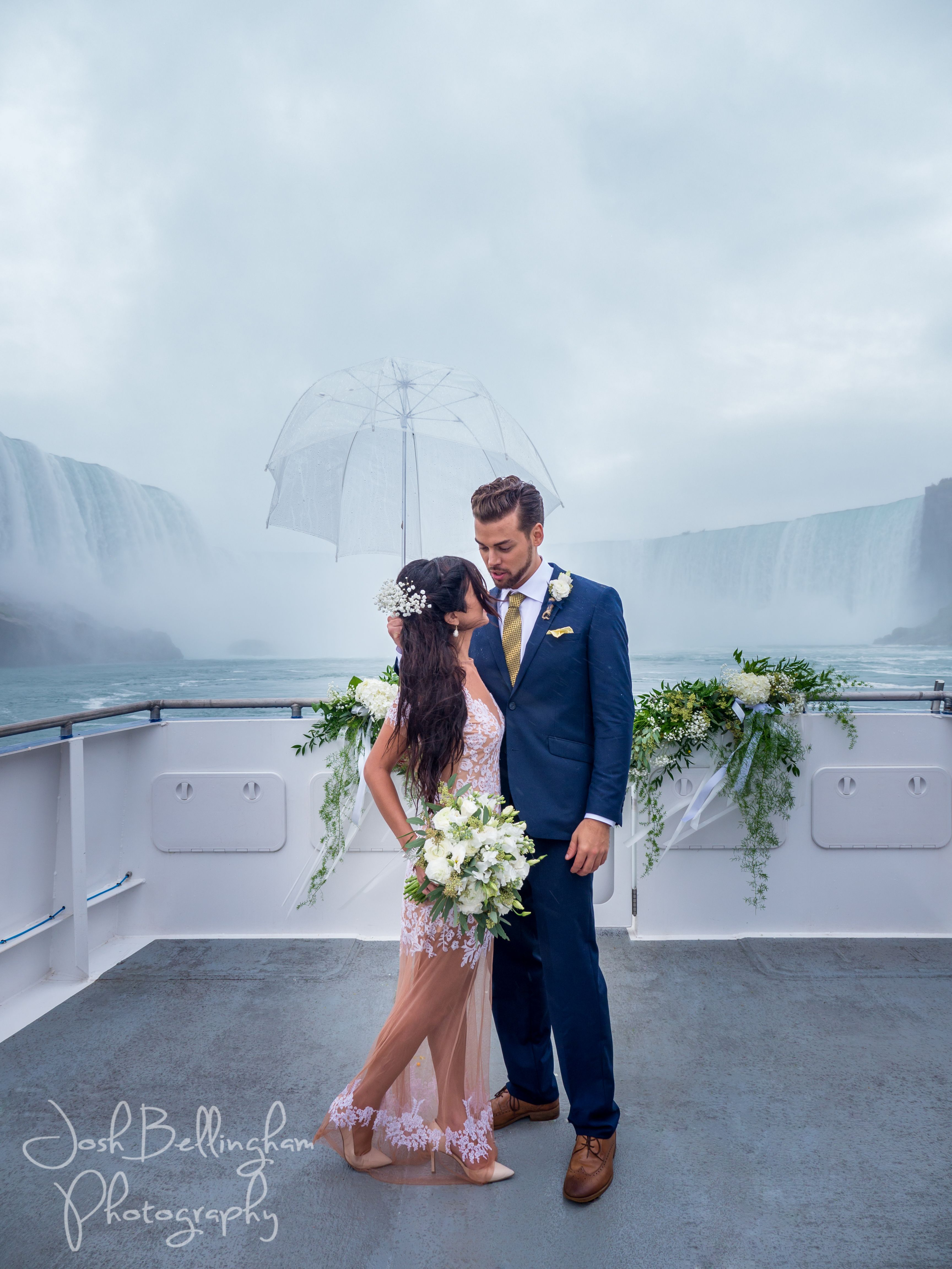 Niagara Falls Wedding Ceremony With Bride And Groom On Boat In Front Of Stunning Water