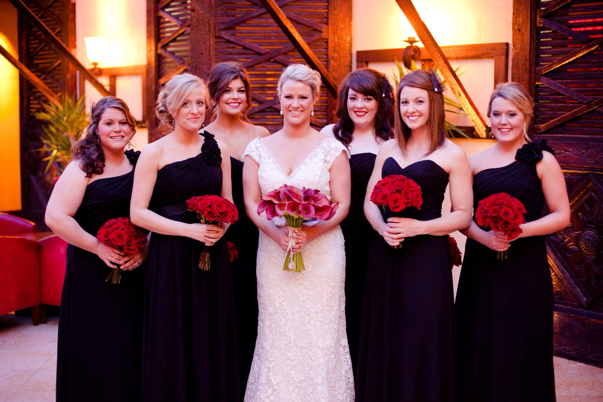Rock and roll red wedding - black bridesmaids dresses with feather ...