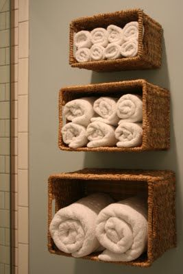 Baskets. A way to keep bath linens close to the shower, and not taking up closet space.  Must try this!