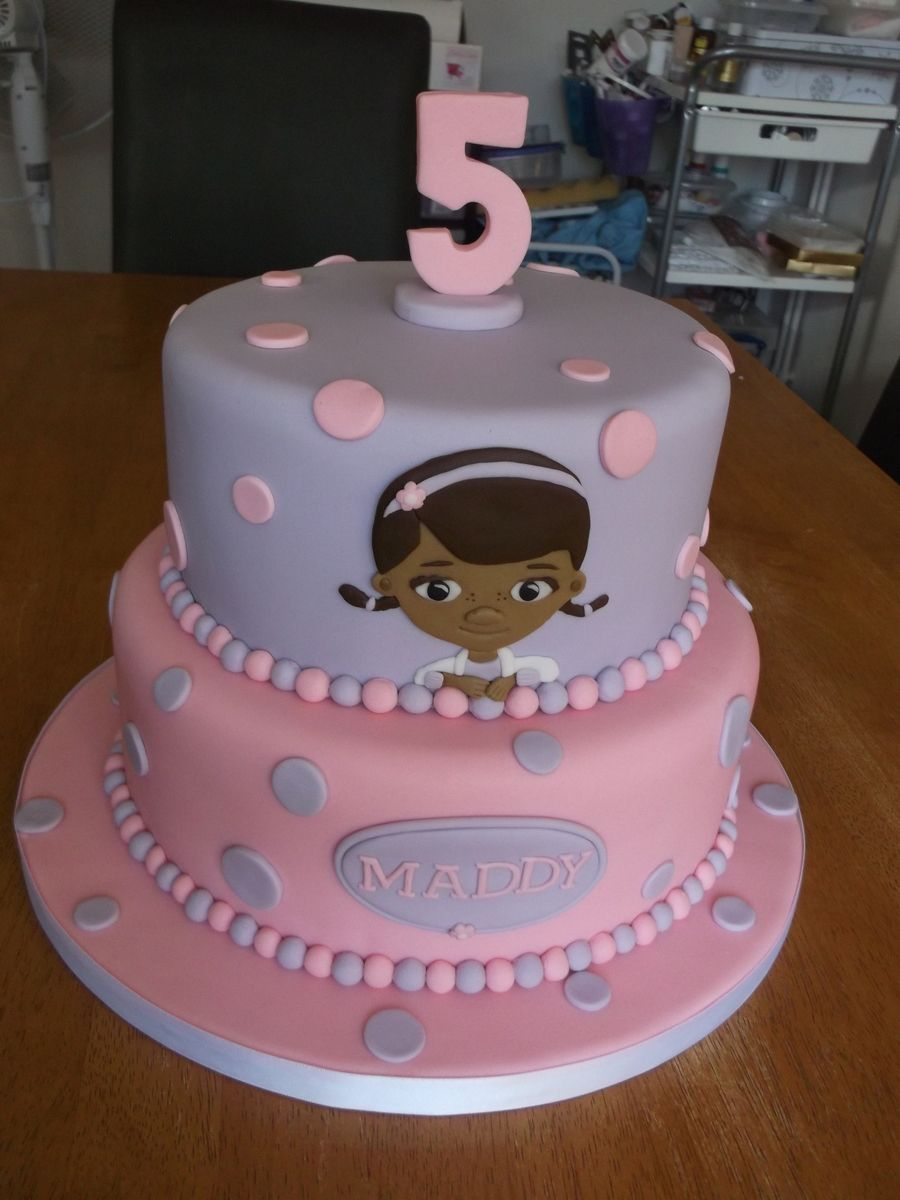 A 7 And 9 Inch Two Tier Cake With Doc Mcstuffins On The Top Tier