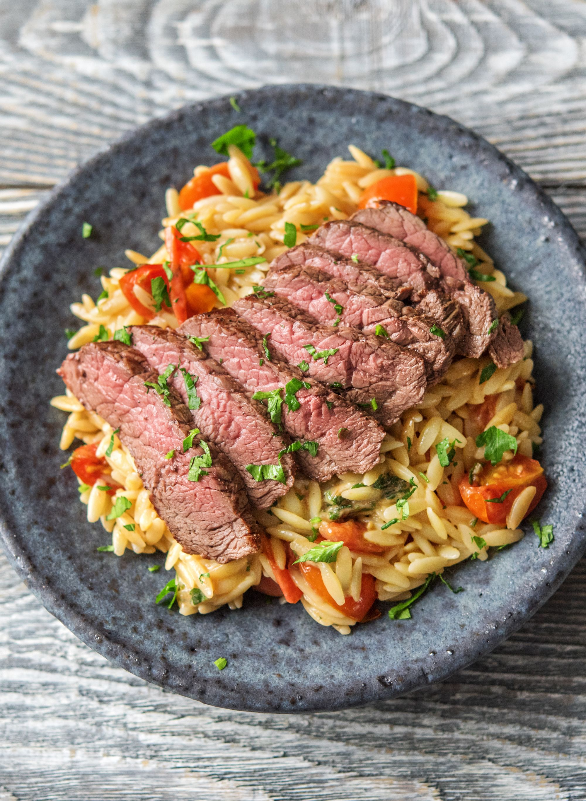 Simple Pasta Salad With Tomatoes Mozzarella And Sired Steak More Wholesome Recipes On Hellofresh Com Hello Fresh Recipes Sirloin Steak Recipes Fresh Food