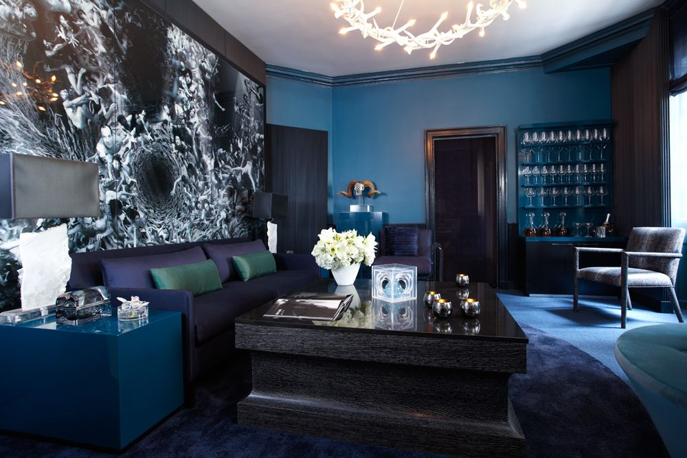 Designer Tips How To Decorate With Dark Colors Dark Living Rooms Living Room Colors Purple Living Room