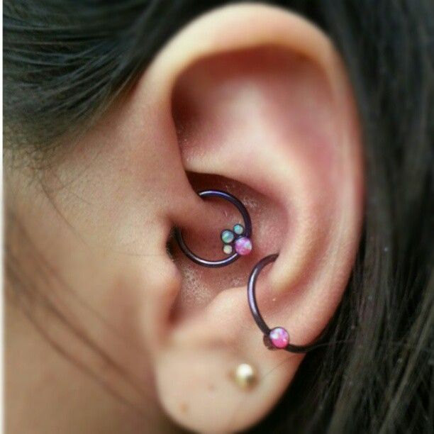 A snazzy daith piercing with a gem cluster by ANATOMETAL with a