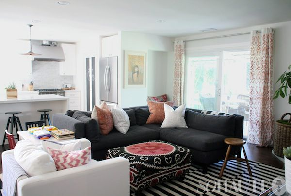 dark grey living room rugs design ideas for small apartment rooms couch sofa stripped rug hipster amber lewis featured on so haute