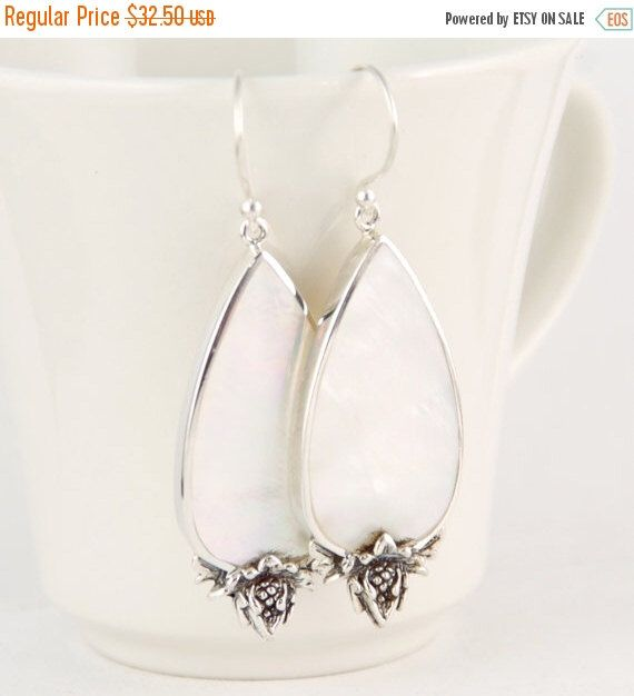 SALE Sterling Silver, Natural Mother of Pearl Earrings, Teardrop Shape by LoveBaliJewelry on Etsy https://www.etsy.com/listing/286385509/sale-sterling-silver-natural-mother-of