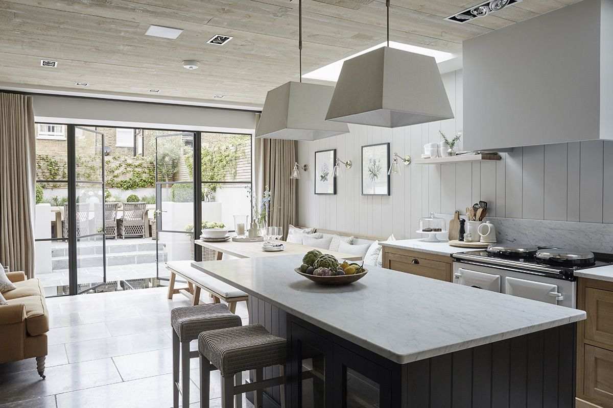 London Open Plan Kitchen With A Large Island And Crittal Windows Opening Out To The Garden