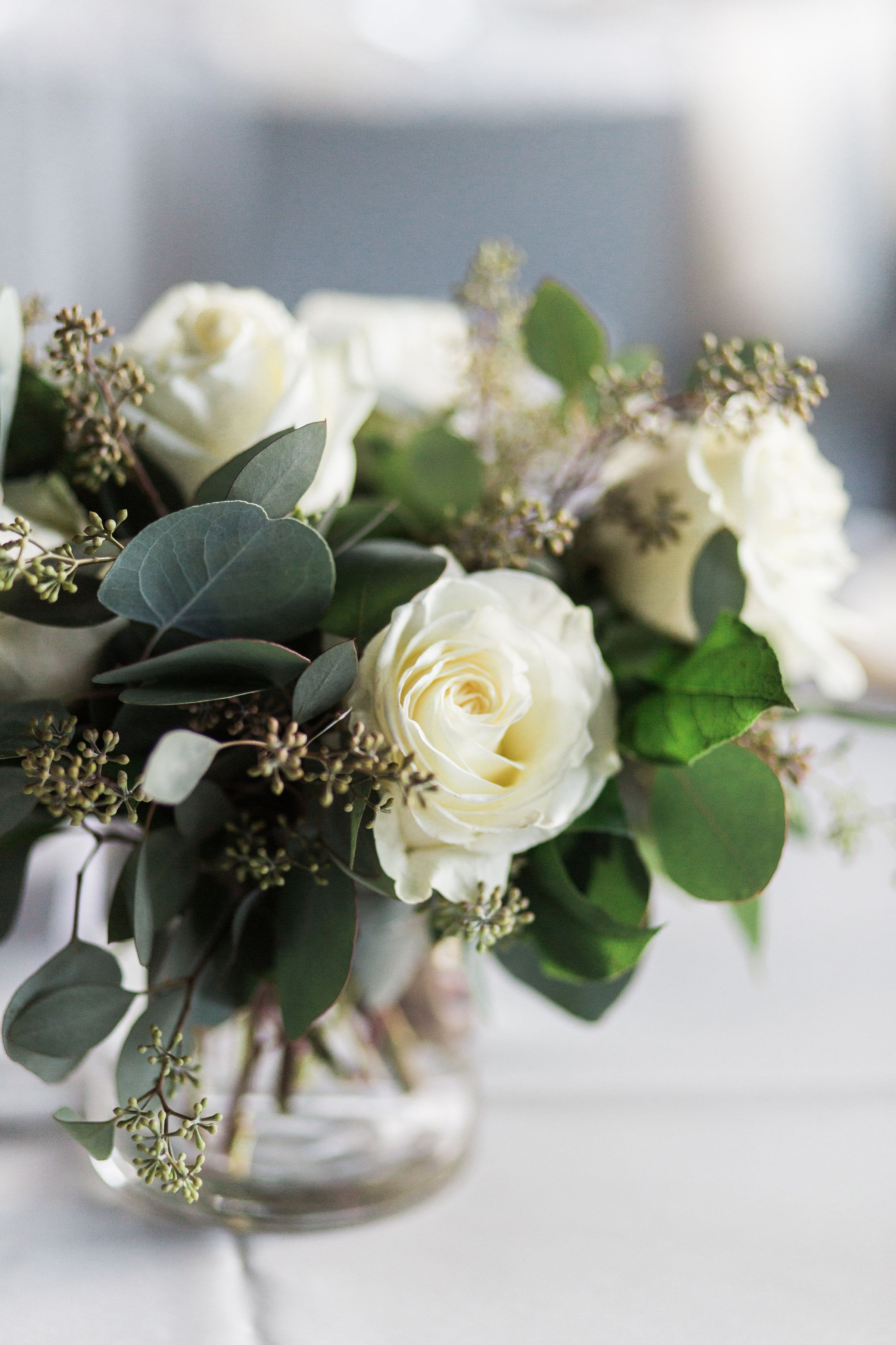 White roses and greenery in bloom weddings pinterest white centerpieces white roses and greenery mightylinksfo Image collections