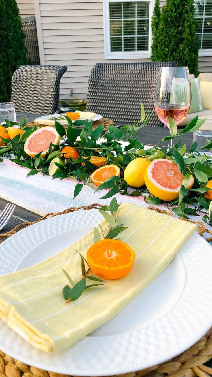 Spring Outdoor Patio Table with oranges and grapefruit centerpieces
