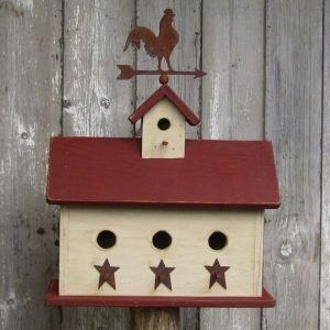 primitive bird house with weather vane.