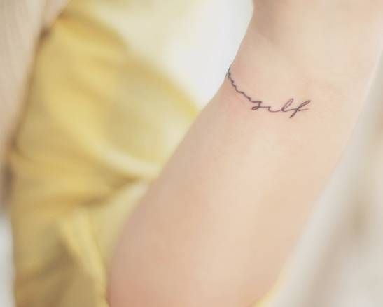 """Love yourself"" tattoo on the wrist by Seoeon."