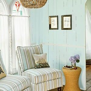 Former Dining Room turned into a cozy Sitting Space that connects front living room and the kitchen. Chairs in front of the windows that overlook the garden and an oversized chandelier makes this such an inviting space. (LOVE the wall color but unable to locate name/brand) Coastal Living Magazine