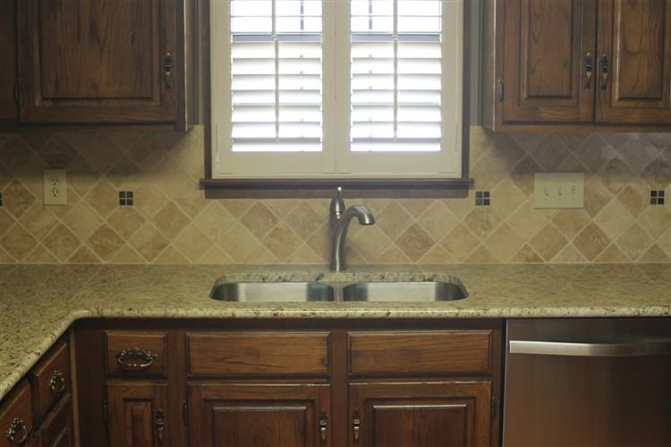 new venetian gold granite countertops and tumbled marble