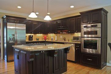 santa cecilia granite with greige subway tile santa cecilia with walnut stain dark cabinets and