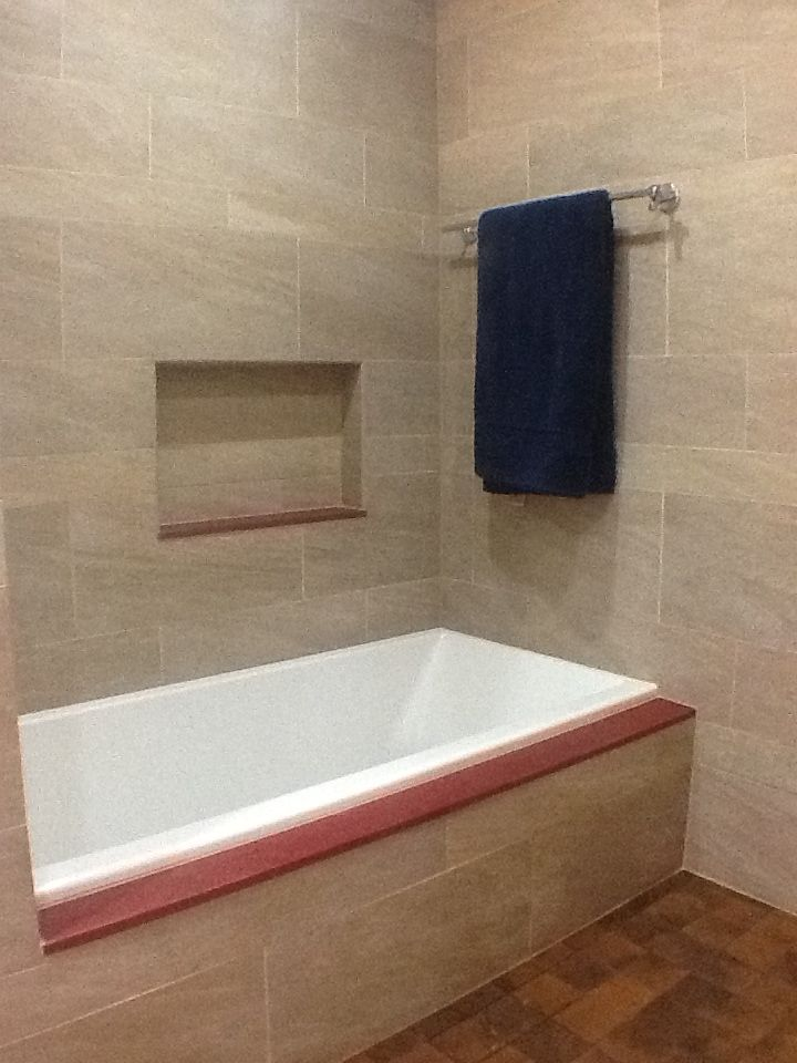 Kohler Underscore tub with cultured marble tub deck and nich ...