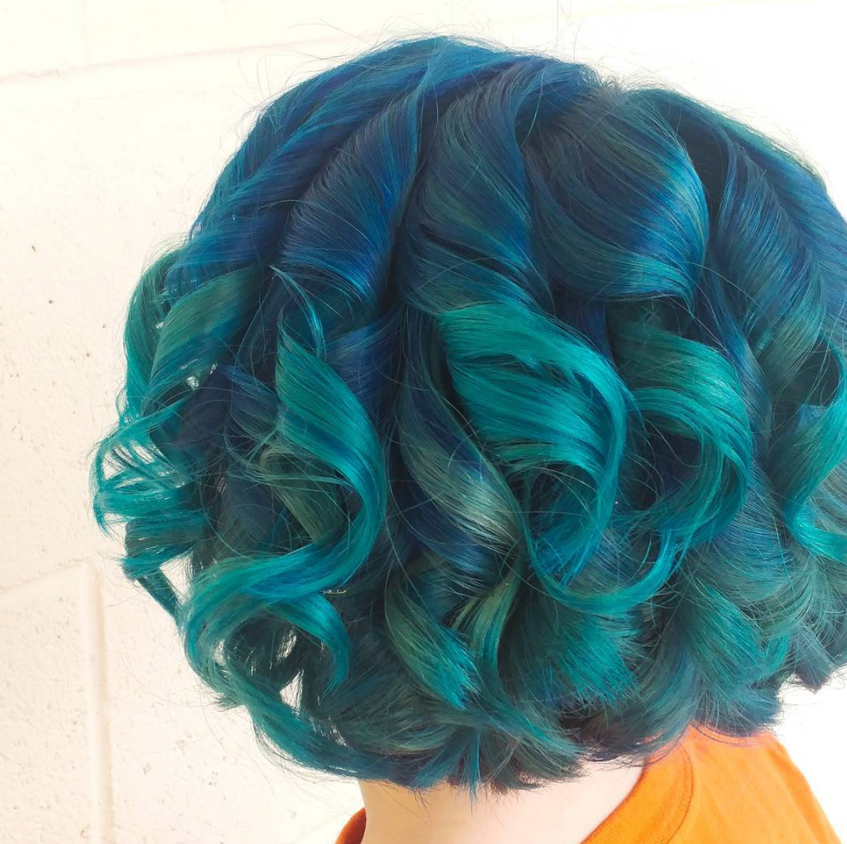 Dark blue and teal hair colors at Oliver Finley Academy of