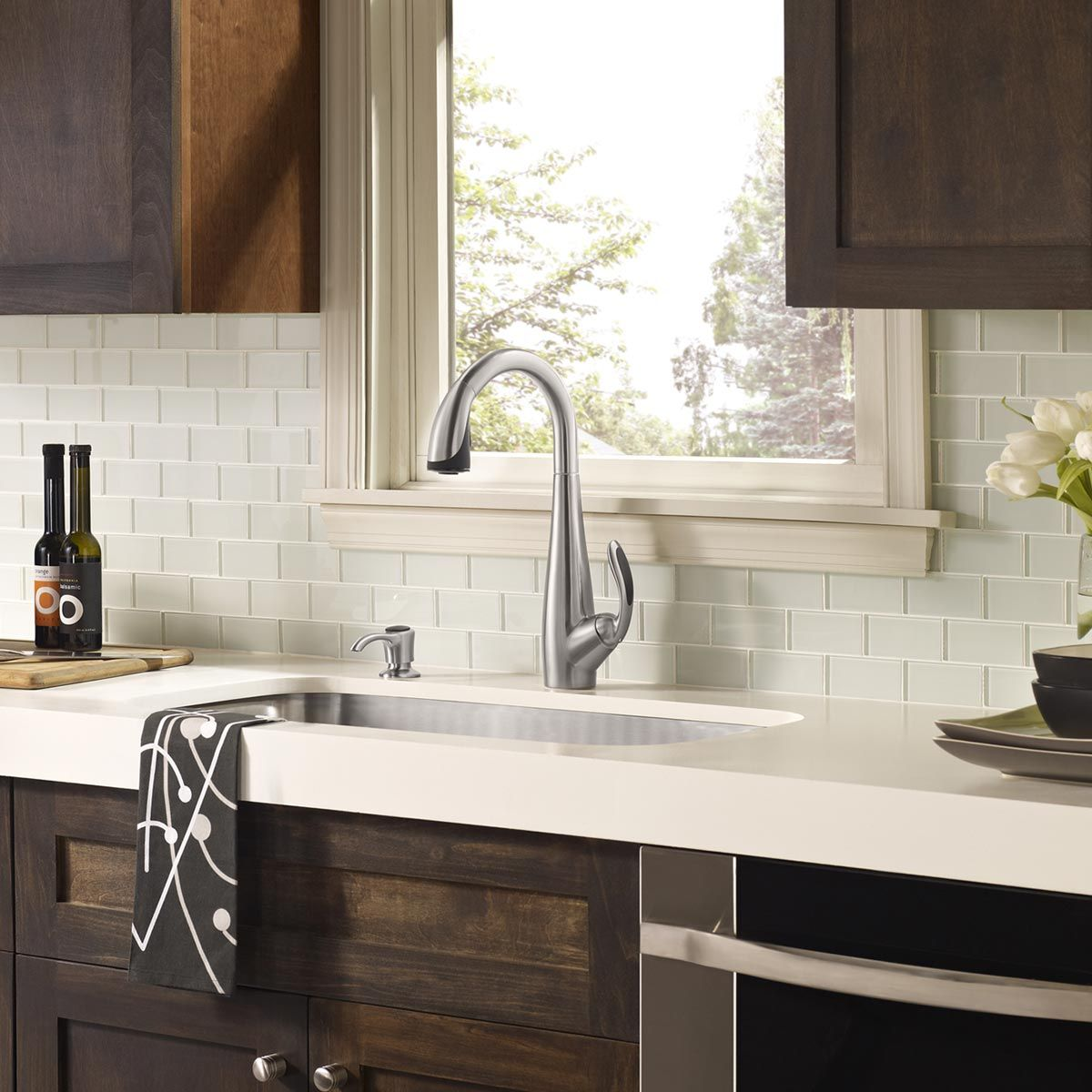 Tile Backsplash With White Cabinets white glass tile backsplash, white countertop with dark wood