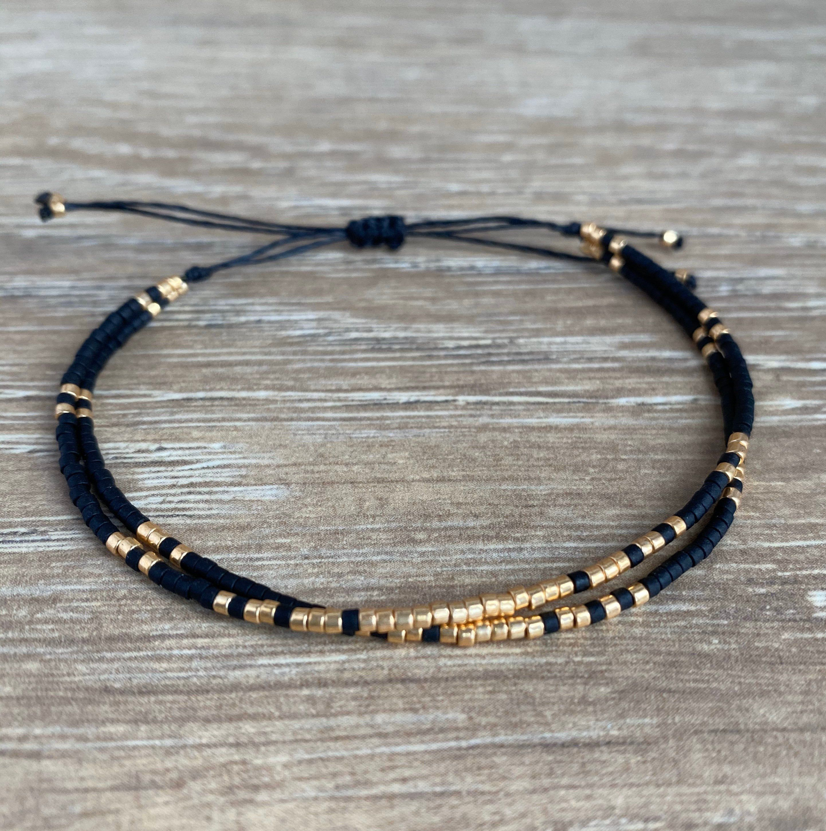 Photo of Minimalist bracelet with miyuki beads, black and gold dainty beaded wax cord jewelry, double strand, gift for girlfriend or mother
