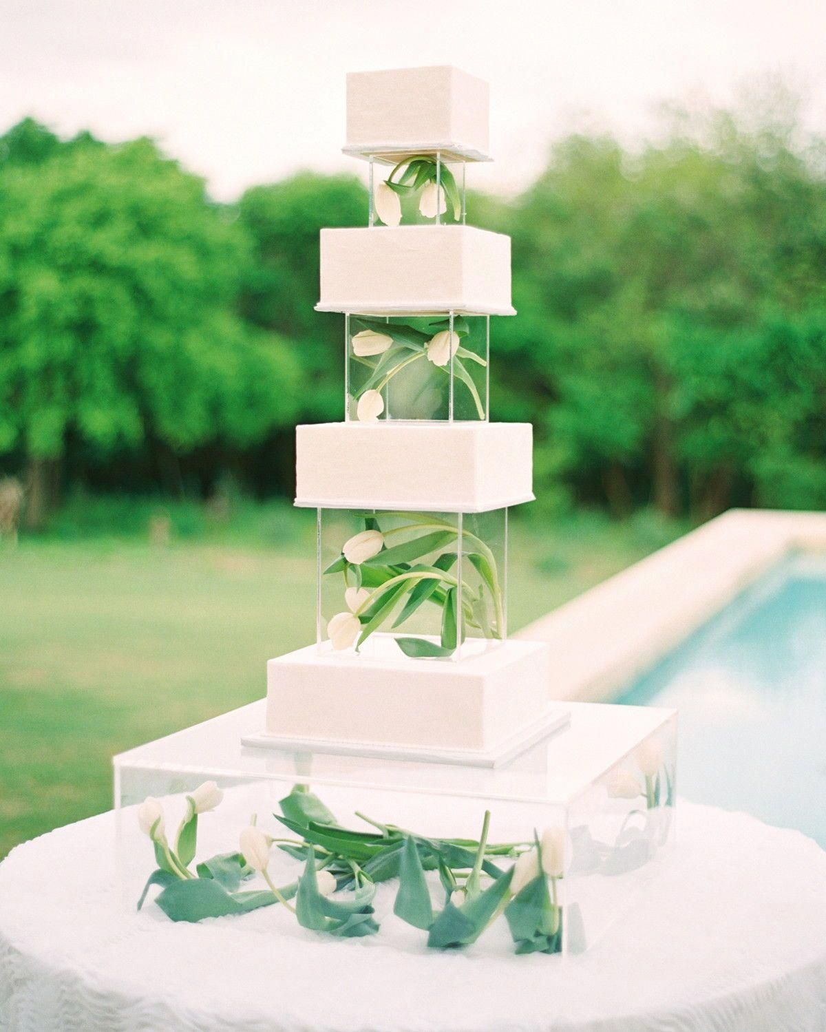 Whether your wedding cake is big or small, a floral tier is the perfect detail for any wedding. You can incorporate your colors and theme with this eye-catching dessert addition. #Wedding #Cake #Tier #Floral #Detail #Unique #WeddingCakeIdeas #Flowers #Dessert #CakeIdeas | Martha Stewart Weddings - Trending Now: Wedding Cakes with Floral Tiers #summerwedding