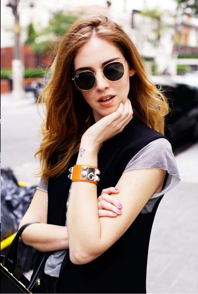 57010b935d9 Chiara Ferragni of The Blonde Salad shows off her round sunglasses.