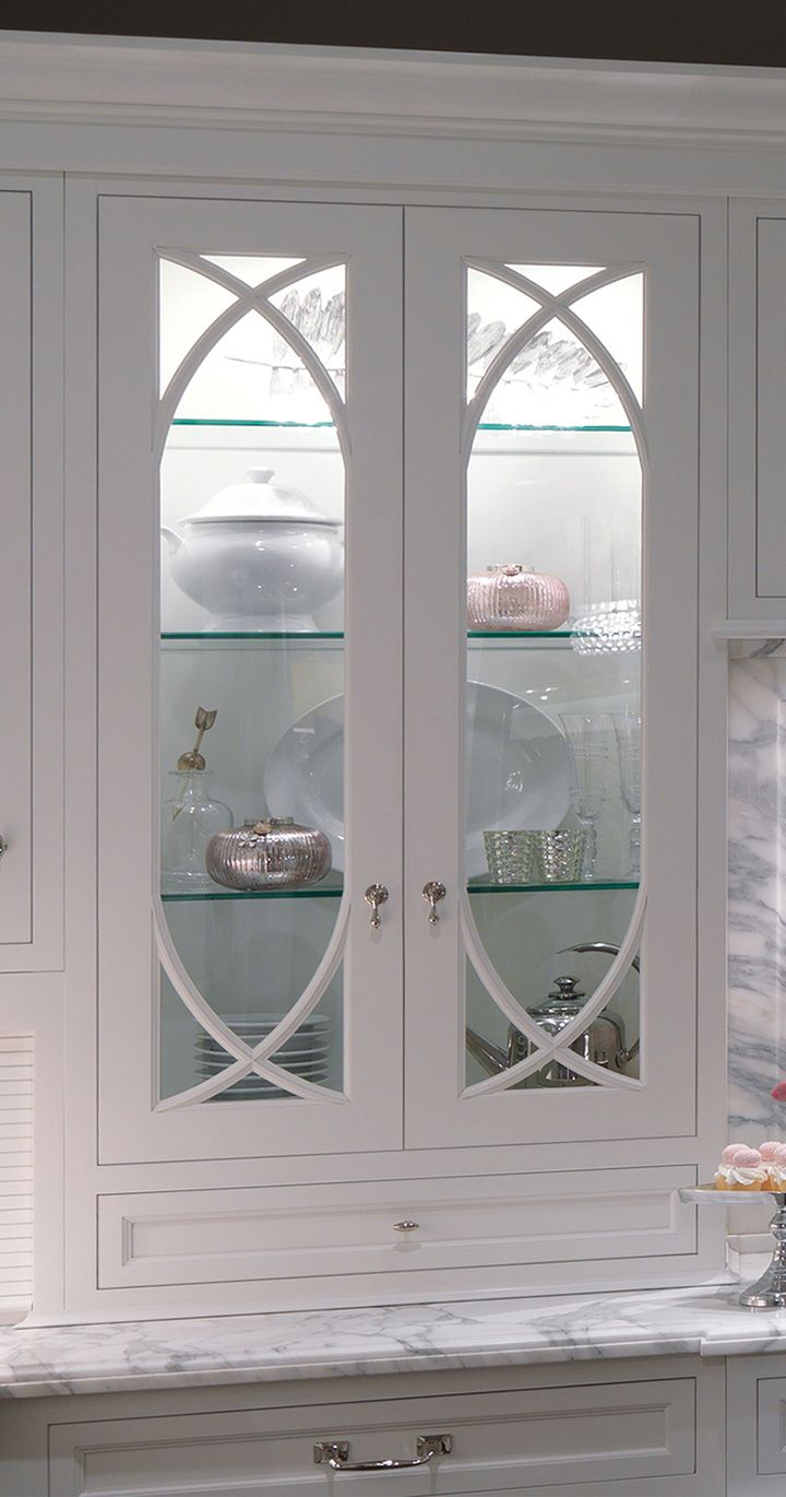 I'd really like wavy glass upper cabinet doors with glass adjustable  shelves, stay cool lighting and leaded glass doors!