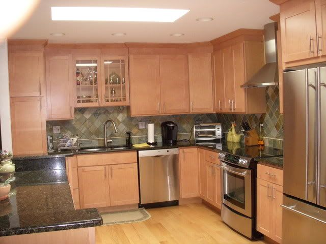 what granite looks best with red oak cabinets - black ... on What Color Granite Goes With Honey Maple Cabinets  id=35782