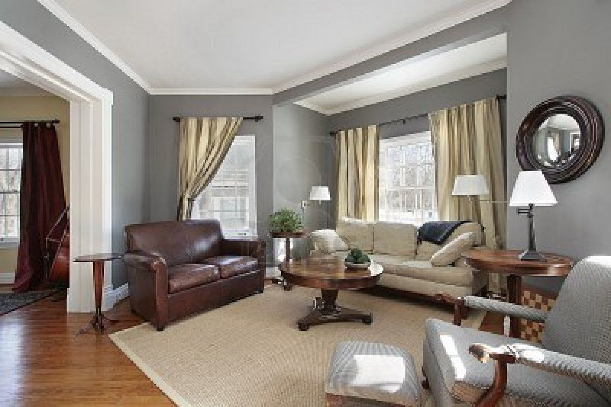 Living Room In Suburban Home With Gray Walls Grey Walls Living Room Brown Living Room Decor Living Room Grey