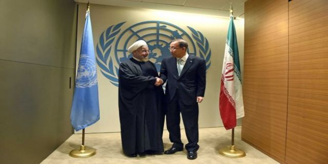 UNITED NATIONS (AP) — Facing a world in turmoil from... World leaders meet with multiple crises on agenda. UN Secretary-General Ban Ki-moon, right, greets Iranian President Hassan Rouhani before a meeting at the United Nations Tuesday, Sept 23, 2014, on the sidelines of the 69th Session of the UN General Assembly. Photo: JEWEL SAMAD, Ap
