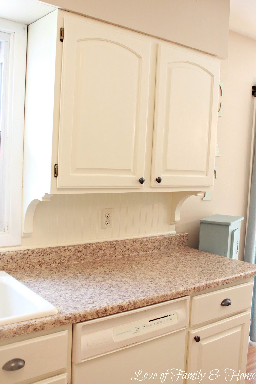 addition of beadboard backsplash & corbels to kitchen cabinets via