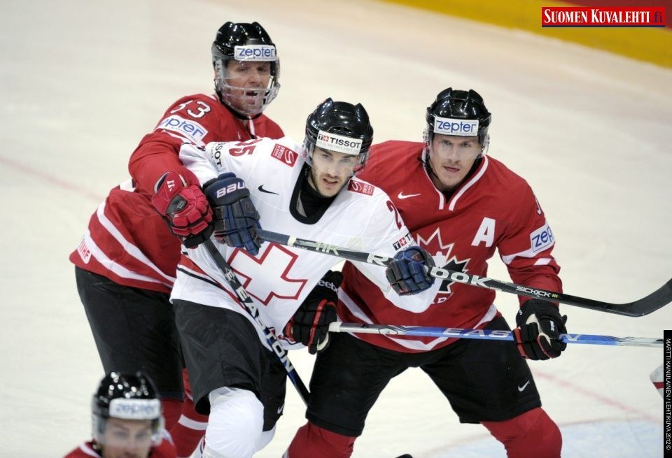 Switzerland S Thibaut Monnet C Is Sandwiched Between Canada S Marc Methot L And Dion Phaneuf During Group H Game Hockey World Ice Hockey World Championship