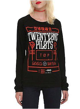 Black pullover top from Twenty One Pilots with a red box logo design on front.<ul><li> 100% cotton</li><li>Wash cold; dry low</li><li>Imported</li><li>Listed in junior sizes</li></ul>